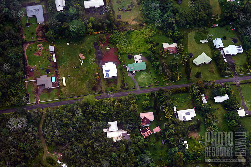 An aerial view of a rural Kea'au neighborhood seen from a helicopter over the Big Island.