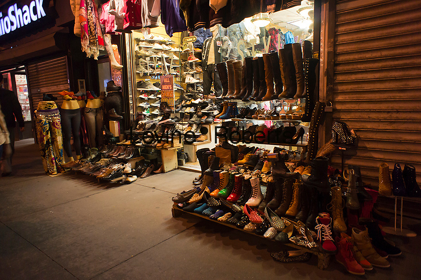 A shoe store on Fulton Street in Lower Manhattan in New York displays its wares on the street in front of the store, seen on Tuesday, October 9, 2012.  Because of the construction of the new downtown transportation hub and the subsequent connecting tunnels being built many businesses along the street have closed due to lost foot traffic. (© Richard B. Levine)