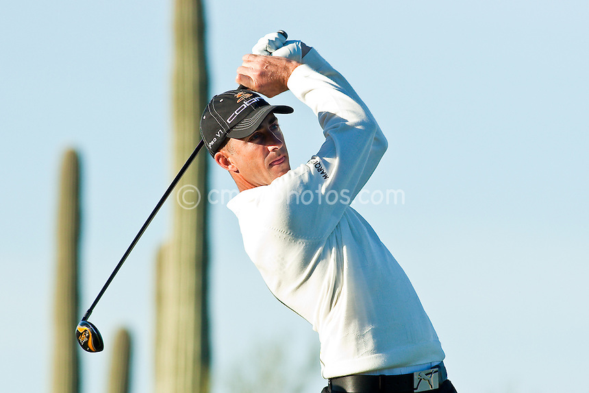 Feb 28, 2009; Marana, AZ, USA; Geoff Ogilvy (AUS) hits his tee shot on the 4th hole during the quarterfinal round of the World Golf Championships-Accenture Match Play Championship at the Ritz-Carlton Golf Club, Dove Mountain.