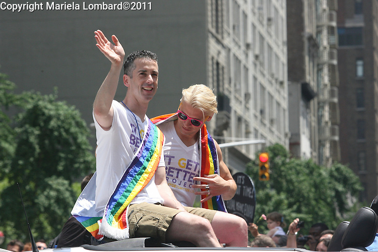"Dan Savage and Terry Miller, creator of ""it Gets Better Project""..Gov. Andrew Cuomo, Mayor Bloomberg and Speaker Christine Quinn march at the gay pride parade along Fifth Ave. in Manhattan.."