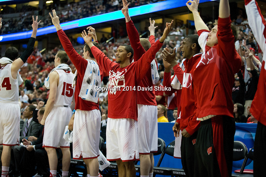 Wisconsin Badgers celebrate a 3-pointer during  a regional semifinal NCAA college basketball tournament game against the Baylor Bears Thursday, March 27, 2014 in Anaheim, California. The Badgers won 69-52. (Photo by David Stluka)