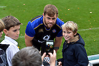 Dave Attwood of Bath Rugby poses for a photo with a supporter after the match. Bath Rugby Captain's Run on October 30, 2015 at the Recreation Ground in Bath, England. Photo by: Patrick Khachfe / Onside Images