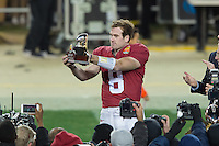 SANTA CLARA, CA - DECEMBER 30, 2014: Kevin Hogan holds the Foster Farms Offense MVP Trophy after Stanford's game against Maryland in the 2014 Foster Farms Bowl.  The Cardinal defeated the Terrapins 45-21.