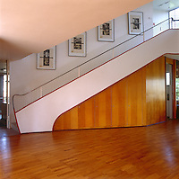 The curved lines of the elegant staircase bring to mind the ocean liners of the 1930's