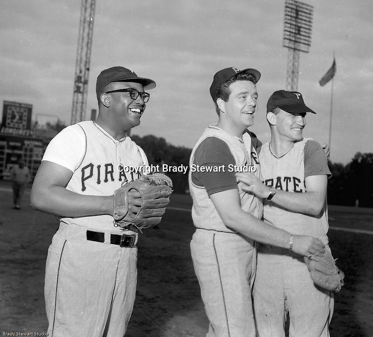 Pittsburgh PA:  View of local TV personalities during the 1966 HYPO (help young players organize) Game between the Pittsburgh Pirates and Milwaukee Braves.  Celebrities include: I believe it's Bill Powell of WAMO (left), Clark Race KDKA Radio and TV (center) and no idea person on the right.<br />