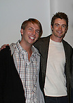 30 Rock's Jack McBrayer poses with Lipstick Jungle's Robert Buckley at the opening night of the Broadway play Rock of Ages on October 16, 2008 at the New World Stages Theatre with curtain call and the after party at Marquee, New York City, New York. (Photo by Sue Coflin/Max Photos)
