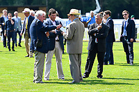 Trainer Andrew Balding middle has a discussion in the parade ring prior to The British Stallion Studs EBF Cathedral Stakes (Listed)(Class 1) during Father's Day Racing at Salisbury Racecourse on 18th June 2017