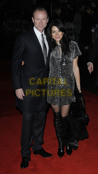 GARY KEMP (SPANDAU BALLET) & LAUREN BARBER.attending the European Premiere of 'Harry Brown' at the Odeon Leicester Square, London, England, UK, November 10th 2009. .full length silver sequined sequin dress otk over the knee boots bag couple suit tie coat couple fur chanel bag handbag 2.55 .CAP/CAN.©Can Nguyen/Capital Pictures
