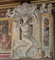 Caryatid in carved stucco, from the frame of the fresco of the Disappointed Venus, by Rosso Fiorentino, 1535-37, in the Galerie Francois I, begun 1528, the first great gallery in France and the origination of the Renaissance style in France, Chateau de Fontainebleau, France. The Palace of Fontainebleau is one of the largest French royal palaces and was begun in the early 16th century for Francois I. It was listed as a UNESCO World Heritage Site in 1981. Picture by Manuel Cohen