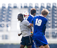 Joshua Yaro (5) of Georgetown goes up for a header with Jason Wellington (17) and Julian Kennedy (19) of Seton Hall during the game at Shaw Field in Washington, DC.  Georgetown defeated Seton Hall, 8-0.