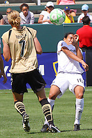 Marta #10 of Los Angeles Sol attempts to avoid being struck by a shot during their match against FC Gold Pride at Home Depot Center on April 19, 2009 in Carson, California.
