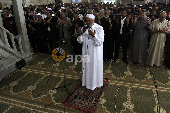 Palestinian Prime Minister in Gaza Ismail Hania, attend  by Legislative Council members, Ministers and Clerics in Gaza, during a prayer for the prisoners in Israeli jails. in Gaza city on April 26, 2012.. Photo by Mohammed Asad