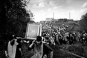 Kirov (Vyatka) Region, Russia  .1998 .A replica of the famous icon, which was found under a tree near the Velikay River, is carried by pilgrims who are making the annual three day journey from Kirov to the Velikaya river. The original icon was lost during the years of communist rule..