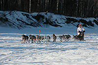 Paul Gefbhardt runs up the south fork of the Kuskokwim River into Nikolai. Photo by Jon Little.