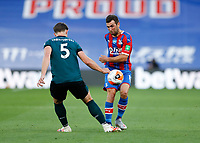 29th June 2020; Selhurst Park, London, England; English Premier League Football, Crystal Palace versus Burnley Football Club; James McArthur of Crystal Palace being challenged by James Tarkowski of Burnley