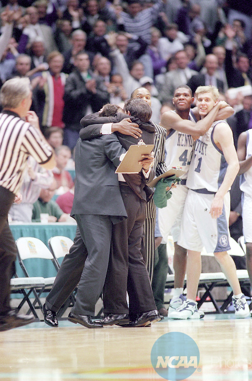 01 APR 1996:  Kentucky Wildcats coach Rick Patino his coaches and team share hugs and celebrate after winning the NCAA National Basketball Championship game at the Meadowlands Arena in East Rutherford, NJ Kentucky defeated Syracuse 76-67 for the title. Rich Clarkson/NCAA Photos