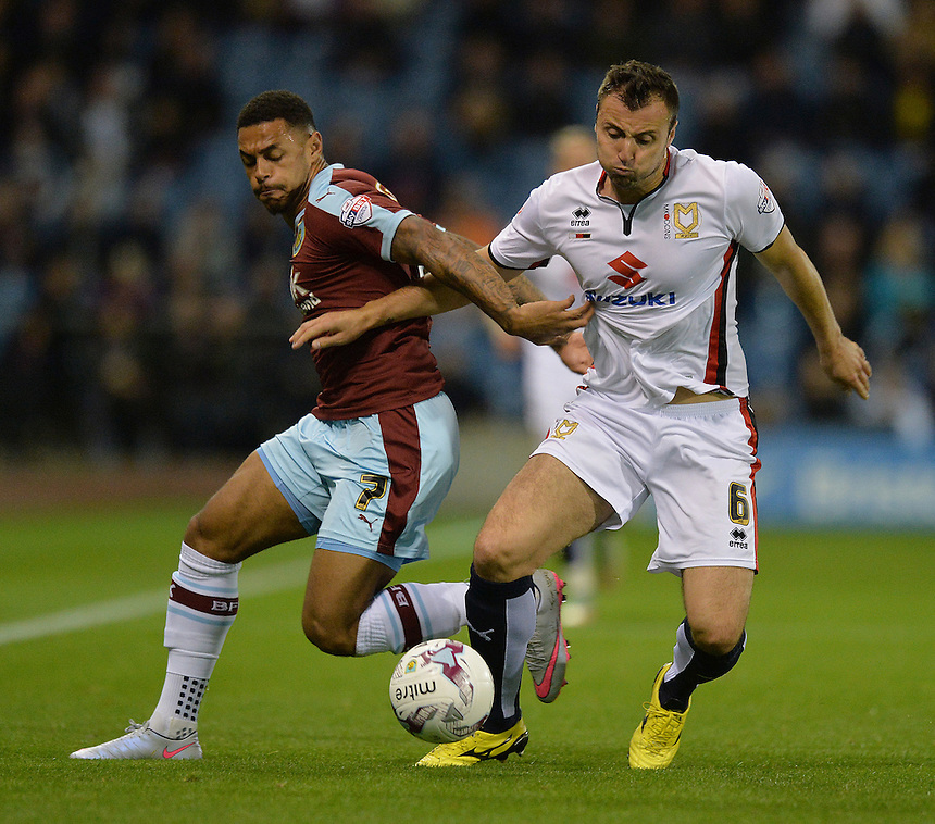 Burnley's Andre Gray battles with  MK Dons' Antony Kay<br /> <br /> Photographer Dave Howarth/CameraSport<br /> <br /> Football - The Football League Sky Bet Championship - Burnley v Milton Keynes Dons - Tuesday 15th September 2015 - Turf Moor - Burnley<br /> <br /> &copy; CameraSport - 43 Linden Ave. Countesthorpe. Leicester. England. LE8 5PG - Tel: +44 (0) 116 277 4147 - admin@camerasport.com - www.camerasport.com