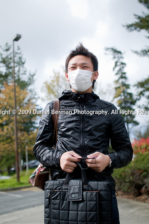"""Ryo T., 20, an international student at a college in north Seattle, wore a face mask to school to allay health concerns. Says Ryo, """"I'm scared I'll get swine flu. I'm scared I'll get sick."""""""