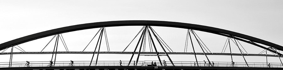 People make their way across the Goodwill Bridge, the pedestrian bridge crossing the Brisbane River and linking Southbank to the Brisbane CBD at the QUT Gardens Point campus.