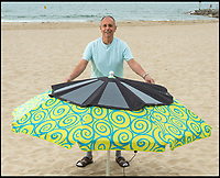 Solarbrella - Charge your devices whilst bagging some rays.