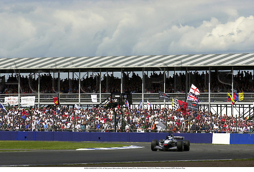 MIKA HAKKINEN (FIN) of McLaren-Mercedes, British Grand Prix, Silverstone, 010715. Photo: Gilles Levent/Action Plus...2001.Formula 1 F1.Motor Racing.Crowd crowds spectators