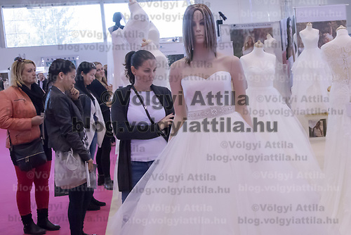 Visitors watch wedding dresses during Wedding Expo in Budapest, Hungary on Nov. 04, 2017. ATTILA VOLGYI