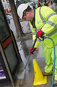 A London Highways Alliance street-cleaning teamat work on a Clean Up Day organised by Edgware Road  Partnership.