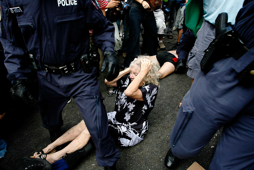 An elderly woman reacts after being knocked to the ground in the midst of an anti-Iraq War protest during the visit of U.S. Vice President Dick Cheney in Sydney, February 23 2007. Photo: Ed Giles.