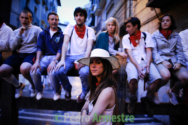 People expect the beginning of the fourth run of the bulls of the San Fermin festival, on July 10, 2012, in the Northern Spanish city of Pamplona. The festival is a symbol of Spanish culture that attracts thousands of tourists to watch the bull runs despite heavy condemnation from animal rights groups (c) Pedro ARMESTRE