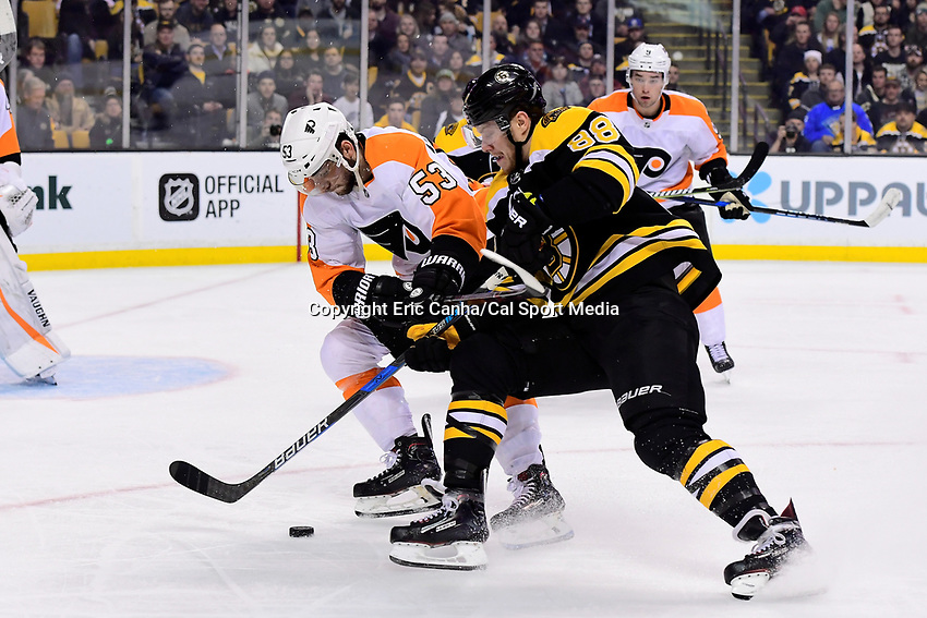 March 8, 2018: Boston Bruins right wing David Pastrnak (88) battles Philadelphia Flyers defenseman Shayne Gostisbehere (53) for the puck during the NHL game between the Philadelphia Flyers and the Boston Bruins held at TD Garden, in Boston, Mass. Boston defeats Philadelphia 3-2 in regulation time. Eric Canha/CSM