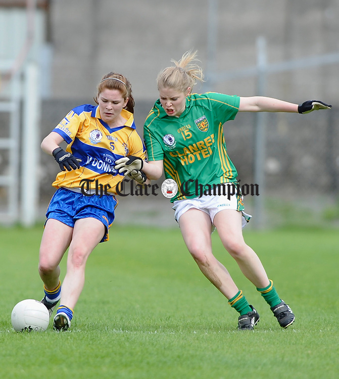 Clare's  Louise Woods and Donegal's  Roisin Mc Donald contest a ball during their All-Ireland U-18A Minor championship final at Tullamore. Photograph by John Kelly.