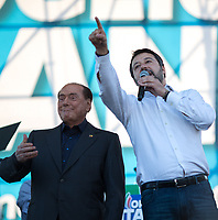 """(From L to R) Silvio Berlusconi MEP (Media tycoon, four times Prime Minister of Italy, leader of Forza Italia party) & Matteo Salvini (Leader of the Lega/League, former Deputy Prime Minister & Minister of the Interior of Italy).<br /> <br /> Rome, 19/10/2019. Today, tens thousands of people (200,000 for the organisers, 50,000 for the police) gathered in Piazza San Giovanni to attend the national demonstration """"Orgoglio Italiano"""" (Italian Pride) of the far-right party Lega (League) of Matteo Salvini. The demonstration was supported by Silvio Berlusconi's party Forza Italia and Giorgia Meloni's party Fratelli d'Italia (Brothers of Italy, right-wing).  <br /> The aim of the rally was to protest against the Italian coalition Government (AKA Governo Conte II, Conte's Second Government, Governo Giallo-Rosso, 1.) lead by Professor Giuseppe Conte. The 66th Government of Italy is a coalition between Five Star Movement (M5S, 2.), Democratic Party (PD – Center Left, 3.), and Liberi e Uguali (LeU – Left, 4.), these last two parties replaced Lega / League as new members of a coalition based on Parliamentarian majority as stated in the Italian Constitution. The Governo Conte I (Conte's First Government, 5.) was 14-month-old when, between 8 and 9 of August 2019, collapsed after the Interior Minister Matteo Salvini withdrew his euroskeptic, anti-migrant, right-wing Lega / League (6.) from the populist coalition in a pindaric attempt (miserably failed) to trigger a snap election.<br /> <br /> Footnotes & Links:<br /> 1. http://bit.do/feK6N<br /> 2. http://bit.do/e7JLx<br /> 3. http://bit.do/e7JKy<br /> 4. http://bit.do/e7JMP<br /> 5. http://bit.do/e7JH7<br /> 6. http://bit.do/eE7Ey<br /> https://www.leganord.org<br /> http://bit.do/feK9X (Source, TheGuardian.com)<br /> Reportage: """"La Fabbrica Della Paura"""" (The Factory of Fear): http://bit.do/feLcy (Source Report, Rai.it - ITA)<br /> (Update) Reportage: """"La Fabbrica Social Della Paura"""" (The Social Network Factory of Fear): http://bit"""