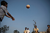 Orphans whose parents were the victims of the Naxalite insurgency play a game of volleyball at their orphanage in Dantewada in Chhattisgarh, India. Photo: Sanjit Das/Panos for The Times