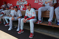 ANAHEIM - JULY 13:  Troy Tulowitzki and Roy Halladay of the National League sits in the dugout before the All Star Game at Angel Stadium on June 13, 2010 in Anaheim, California. Photo by Brad Mangin