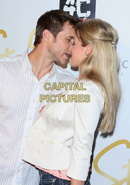 "JAKE PAVELKA & VIENNA GIRARDI.""Dancing With Stars"" Derek Hough and Mark Ballas Birthday Celebration held at H Lounge, West Hollywood,.California, USA. .May 17th, 2010.half length white jacket shirt profile kiss kissing .CAP/ADM/TC.©T. Conrad/AdMedia/Capital Pictures."