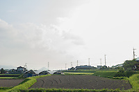 Rural Kagawa scenery: fields lead off to low, knobbly mountains typical of the area.