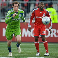 Nate Jaqua (21) for the Seattle Sounders FC and Marvell Wynne (16) of Toronto FC in action at BMO Field on April 4, 2009.Seattle won 2-0.
