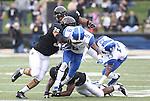 UK wide receiver Demarco Robinson gets tackled by Vanderbilt defenders during the first half of the University of Kentucky vs. Vanderbilt University football game at Vanderbilt Stadium in Nashville, Tenn., on Saturday, November 16, 2013. Vanderbilt won 22-6. Photo by Tessa Lighty | Staff