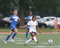 Sky Blue FC midfielder Taylor Lytle (6) passes the ball.  In a National Women's Soccer League Elite (NWSL) match, Sky Blue FC (white) defeated the Boston Breakers (blue), 3-2, at Dilboy Stadium on June 16, 2013.