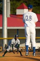 Tim Beckham (6) of the Princeton Rays keeps an eye on Burlington Royals pitcher John Flanagan (28) at Burlington Athletic Park in Burlington, NC, Monday August 11, 2008. (Photo by Brian Westerholt / Four Seam Images)