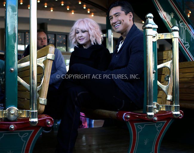 WWW.ACEPIXS.COM....January 10 2013, LA....Singer Cyndi Lauper joined Mario Lopez for a taping of 'Extra' at The Grove on January 10 2013 in Los Angeles, CA.....By Line: Nancy Rivera/ACE Pictures......ACE Pictures, Inc...tel: 646 769 0430..Email: info@acepixs.com..www.acepixs.com