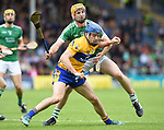 Shane O'Donnell of Clare in action against Richie English of Limerick during their Munster Championship semi-final at Thurles.  Photograph by John Kelly.