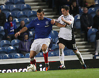 Lee McCulloch holds off Nicky Clark in the Rangers v Queen of the South Quarter Final match in the Ramsdens Cup played at Ibrox Stadium, Glasgow on 18.9.12.