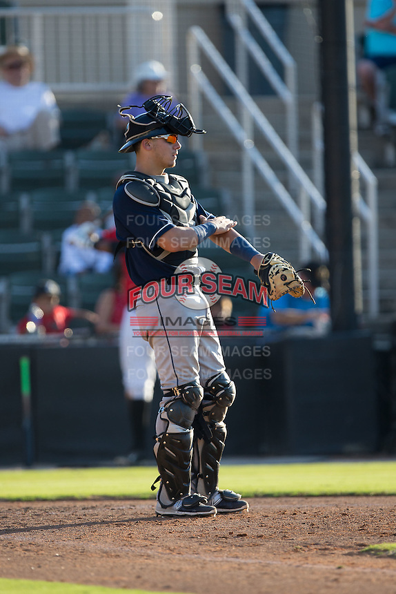 Asheville Tourists catcher Dom Nunez (9) gives defensive signs to his infielders during the game against the Kannapolis Intimidators at Intimidators Stadium on June 28, 2015 in Kannapolis, North Carolina.  The Tourists defeated the Intimidators 6-4.  (Brian Westerholt/Four Seam Images)