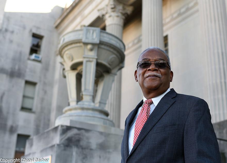 Retired Criminal Court Judge Calvin Johnson stands stands outside of Orleans Parish Criminal Court.