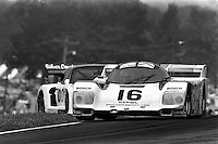 "LEXINGTON, OH - JUNE 9: The Dyson Racing Porsche 962 101 driven by Drake Olsen and Rob Dyson lifts a wheel in the ""Keyhole"" corner during the Lumbermens 500k IMSA GTP/Lights race at the Mid-Ohio Sports Car Course near Lexington, Ohio, on June 9, 1985. (Photo by Bob Harmeyer)"