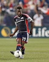 New England Revolution midfielder Clyde Simms (19) passes the ball. In a Major League Soccer (MLS) match, the New England Revolution defeated Columbus Crew, 2-0, at Gillette Stadium on September 5, 2012.