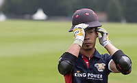 Apichet Srivaddhanaprabha (King Power) gets ready for the golden goal as the score ends 10-10 during the Cartier Trophy Final match between King Power and Salkeld at the Guards Polo Club, Windsor, Smith's Lawn, England on 14 June 2015. Photo by Andy Rowland.