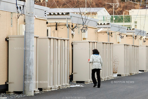 A woman walks between a temporary prefab housing in Minamisanriku on February 10, 2016, Miyagi Prefecture, Japan. <br /> A few weeks before of the fifth anniversary of 2011 Tohoku Earthquake and Tsunami, the Japanese government announced that the second half of the reconstruction work in the Tohoku area is expected to be concluded before the 2020 Tokyo Olympics begin. <br /> According to the official Reconstruction Agency's website approximately $250 billion were allocated to the first period (2011-2015) and $65 billion more have been set aside for a ''Reconstruction and Revitalisation Period'' starting from fiscal 2016. The Agency also reported that the number of evacuees has decreased from over 470,000 to about 180,000 in the 5 years since the disaster. According to the latest Japanese National Police Agency figures (published on February 10, 2016) 15,894 people died as a result of the earthquake and tsunami and 2,562 are still listed as missing; 6,152 people were injured, and 121,803 properties collapsed. <br /> Areas devastated by the earthquake and tsunami like Minamisanriku, Kesennuma, Onagawa, and Ishinomaki are in the process of recovery but reconstruction in parts of Fukushima will take much longer due to radiation contamination. (Photo by Rodrigo Reyes Marin/AFLO)