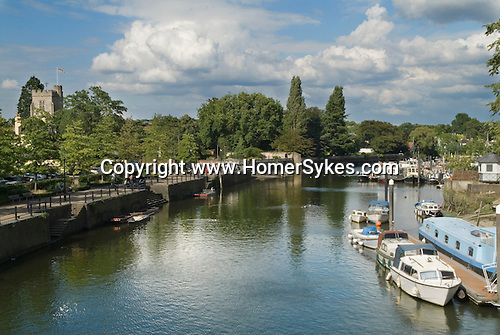 River Thames at Twickenham Middlesex. Eel Pie island boats yard. The Embankment and St Marys parish church View looking upriver towards London and Richmond.